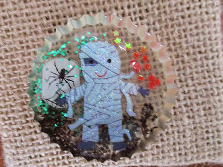 A Mummy and Her Spider Cabochon